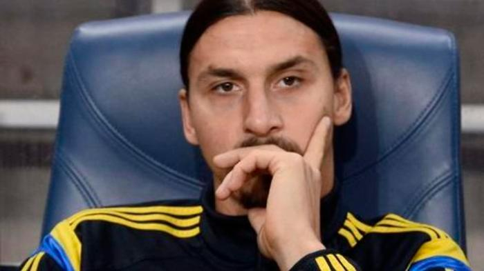 Sweden's striker Zlatan Ibrahimovic watches from the bench during the Euro 2016 qualification match between Sweden and Russia at Friends Arena in Stockholm