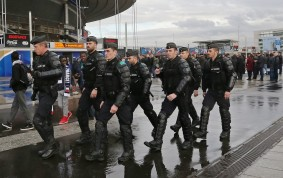 29 Mar 2016, Paris, France --- PARIS, FRANCE. MARCH 29, 2016. Police officers outside the Stade de France ahead of a friendly football match between France and Russia. Alexander Demianchuk/TASS --- Image by © Alexander Demianchuk/ITAR-TASS Photo/Corbis